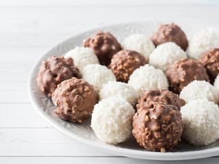Chocolate and Coconut Candy on a Plate of White background