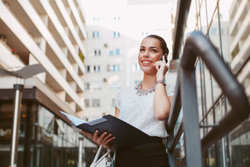 Young business woman outside on the phone