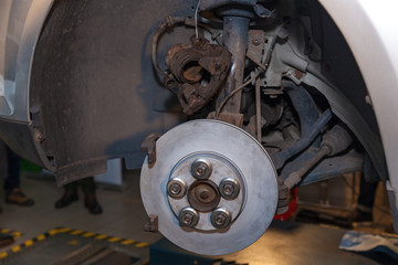 Disc brake in the car close-up on the side. Disc brake in the car.