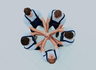 Large group of workers standing in circle.