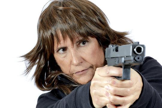 Attractive Woman aiming a Handgun