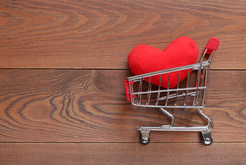 Red plush heart in the small shopping cart