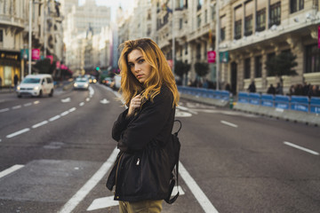 Woman posing on road