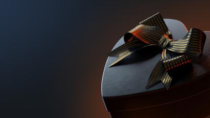 Closeup of black heart shaped gift box