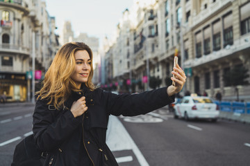 Woman using smartphone on road