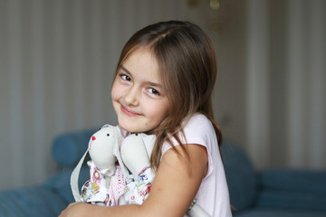 Pretty girl hugging bunny rabbits