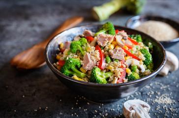 Quinoa salad with tuna, broccoli, peas, corn and mushrooms