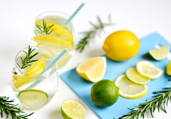 Glasses with Fresh Water Rosemary Lemon Lime Fruits White Background Beverage Healthy Lifestyle