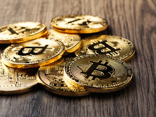bitcoin coin model on wooden board