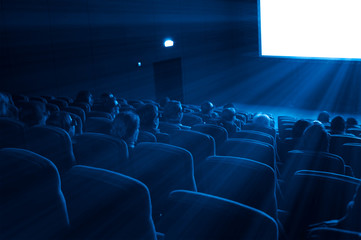 viewers watch a 3D movie, blue toning