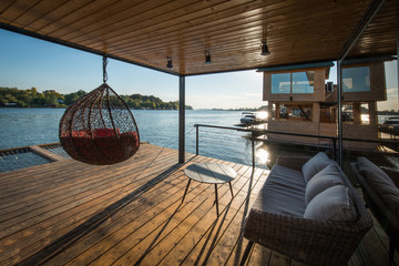Sofa and hammock on terrace of raft cottage