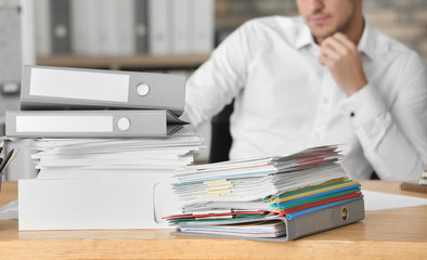 Stack of documents on office employee's table, closeup