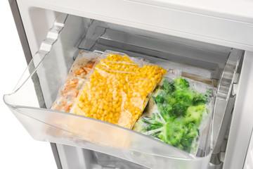 Frozen vegetables in refrigerator, closeup