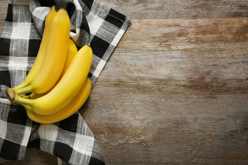 Ripe bananas on wooden background