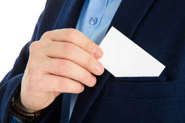 Businessman hand holding a business card over suit pocket, closeup. Isolated on white.