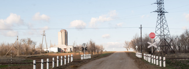 Cowsheds, farm and silo with a field in the foreground. Southern Russia. The Volga-Don