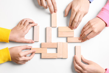 People with wooden blocks on white background. Unity concept
