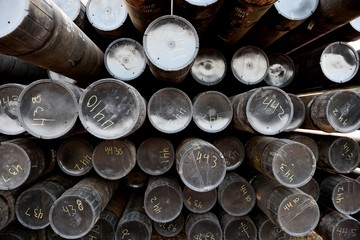 Rack of numbered iron pipes used for oil and gas exploration and extraction in Wyoming / USA.
