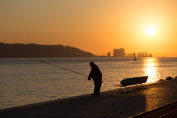 fisherman on river tagus in lisbon