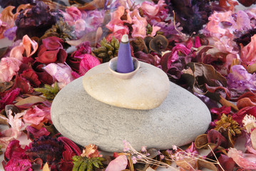 Burning incense cone with smoke