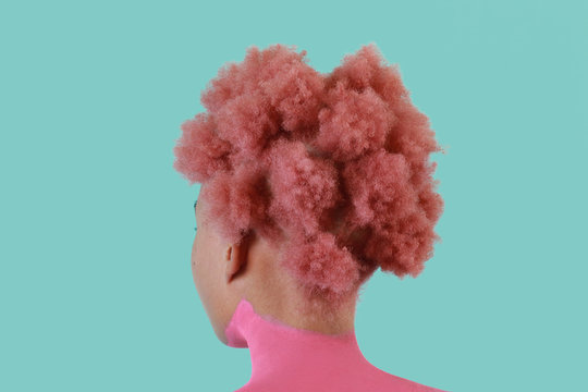 Woman with pink afro and body paint