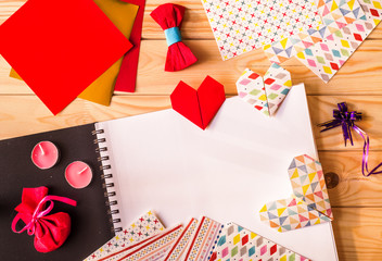 hand made origami paper hearts for valentine's day surrounded by origami paper