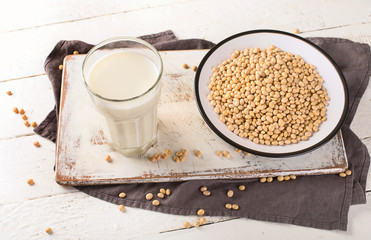 Soymilk and soybean on wooden table.