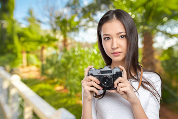 Woman using a retro photo camera