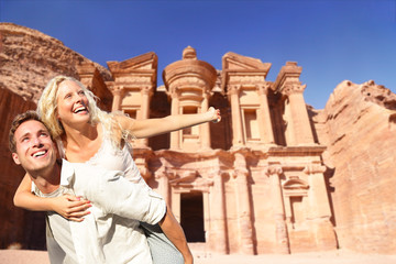 Jordan travel couple tourists happy at The Monastery, Petra's largest monument, in Jordan.