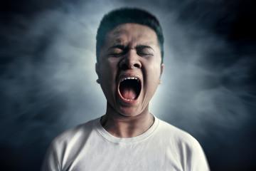 Asian man screaming