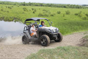 Tourists on all-terrain vehicles. On ATV