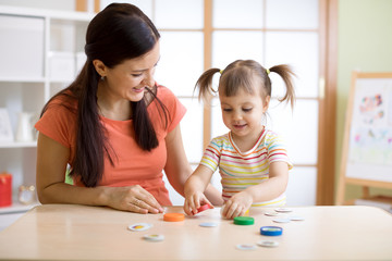 Mom with creative child having fun time together