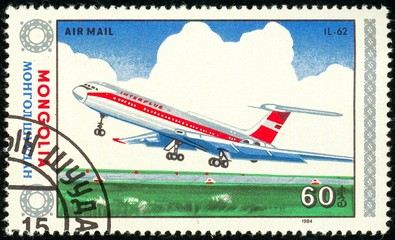 Ukraine - circa 2018: A postage stamp printed in Mongolia show aircraft Il-62. Series: Airplanes. Circa 1984.