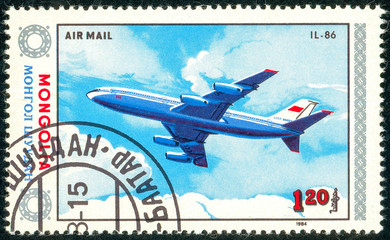 Ukraine - circa 2018: A postage stamp printed in Mongolia show aircraft Il-86. Series: Airplanes. Circa 1984.