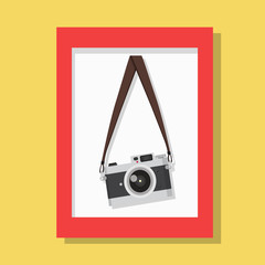 hanging vintage camera  with red picture frame