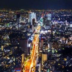 Asia Business concept for real estate & corporate construction - panoramic modern city skyline view of Shibuya & Tokyo Metropolitan Expressway with neon night in Roppongi Hill, Tokyo, Japan