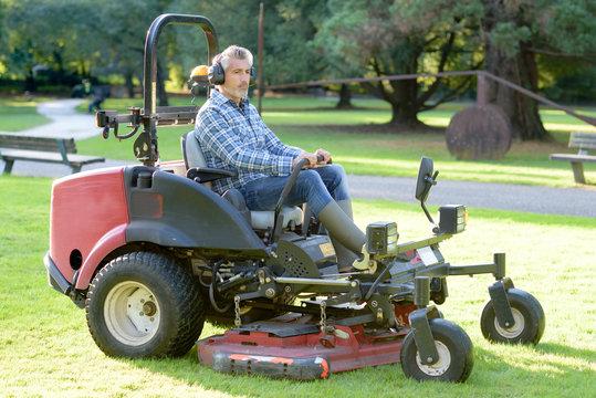 Man driving professional mower