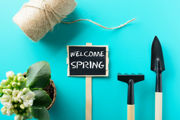 Welcome Spring sign with tools on table