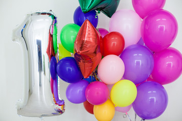 multi-colored balloons and gifts for the holiday
