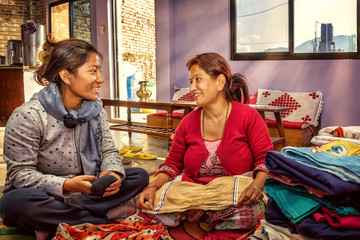 Mother and Daughter Folding the Laundry, Nepal