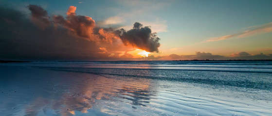 Storm Clouds at sunset over West Wittering Beach, West Sussex, UK