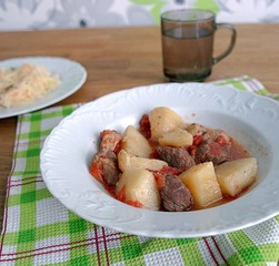 Pork, stewed with potatoes, tomatoes and sweet peppers