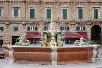 Fountain with lions in the central square of Pesaro