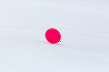 one red balloon in snowy winter landscape