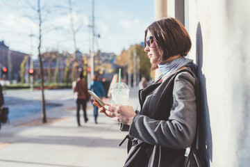 young woman using smart phone outdoor