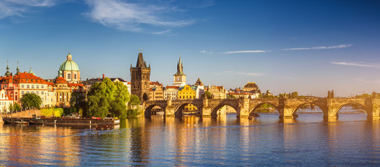 Poster Prague View of the Vltava River and the bridges shined with the sunset sun, Prague, the Czech Republic