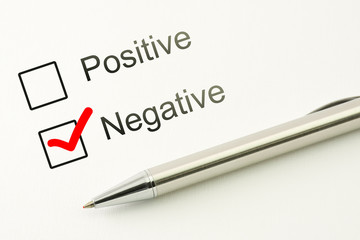 questionnaire: negative choice or positive, marked checkbox with a pen on paper background. Disapproval concept