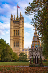 Buxton Memorial Fountain in Victoria Tower Gardens with House of Lords Victoria Tower Westminster London UK