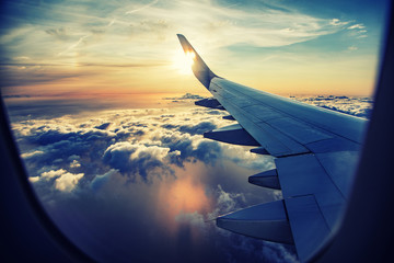Printed kitchen splashbacks Airplane flying and traveling, view from airplane window on the wing on sunset time