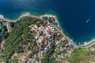 Aerial view of motor boats that run along the water surface leaving a white trail. Montenegro.